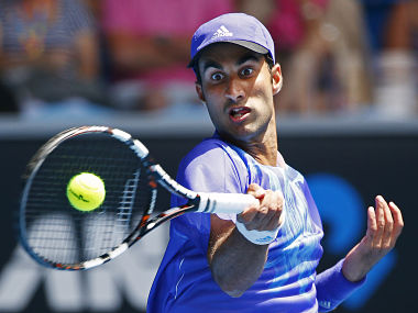 Yuki Bhambri of India hits a return to Andy Murray of Britain during their men's singles first round match at the Australian Open 2015 tennis tournament in Melbourne January 19, 2015. Bhambri lost the match to Murray. REUTERS/Athit Perawongmetha (AUSTRALIA - Tags: SPORT TENNIS) - RTR4LXWY