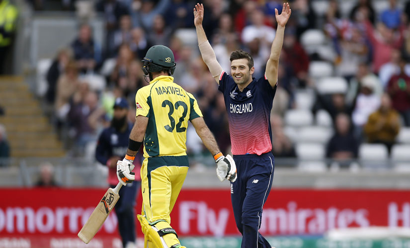 England's Mark Wood celebrates the wicket of Australia's Glenn Maxwell. Reuters