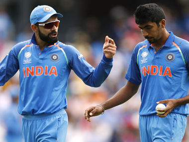 India's Virat Kohli (L) and Jasprit Bumrah. Reuters