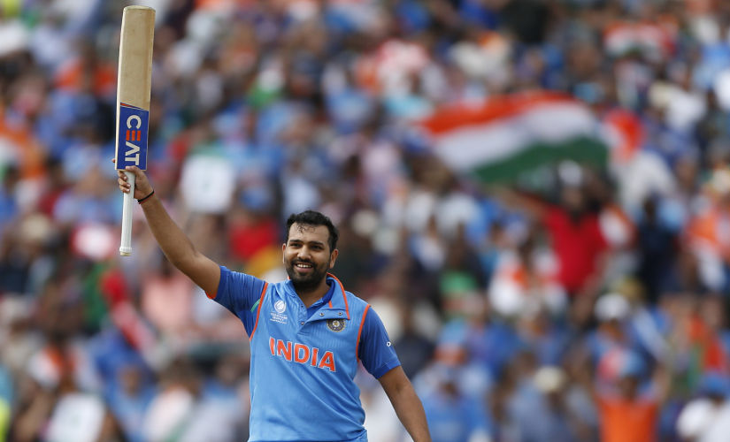 Britain Cricket - India v Bangladesh - 2017 ICC Champions Trophy Semi Final - Edgbaston - June 15, 2017 India's Rohit Sharma celebrates scoring a century Action Images via Reuters / Andrew Boyers Livepic EDITORIAL USE ONLY. - RTS178C3