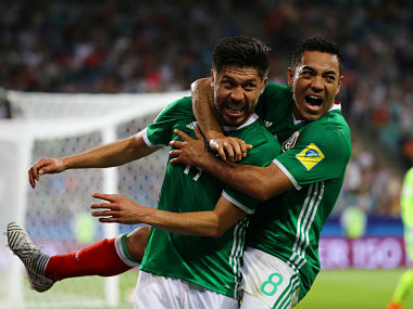Mexico's Oribe Peralta celebrates scoring their second goal with Marco Fabian . REUTERS