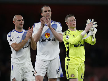 "Britain Football Soccer - Arsenal v Sunderland - Premier League - Emirates Stadium - 16/5/17 Sunderland's Jordan Pickford, Darron Gibson and John O'Shea applaud fans after the match Action Images via Reuters / Paul Childs Livepic EDITORIAL USE ONLY. No use with unauthorized audio, video, data, fixture lists, club/league logos or ""live"" services. Online in-match use limited to 45 images, no video emulation. No use in betting, games or single club/league/player publications. Please contact your account representative for further details. - RTX364HX"