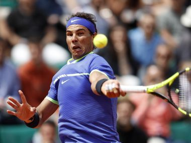Rafael Nadal slams a forehand during this fourth round at the French Open. AP