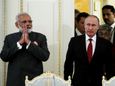 Narendra Modi with Vladimir Putin in St. Petersburg on Thursday. AP/PTI