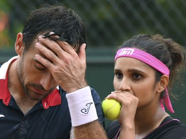 India's Sania Mirza (R) speaks to Croatia's Ivan Dodig during their mixed doubles tennis match against Croatia's Darija Jurak and Croatia's Mate Pavic at the Roland Garros 2017 French Open on June 2, 2017 in Paris. / AFP PHOTO / FRANCOIS XAVIER MARIT
