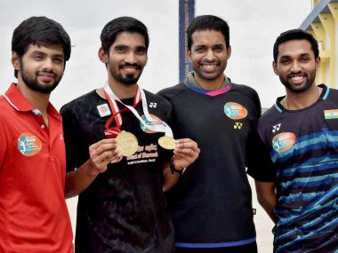 Hyderabad: Badminton player Kidambi Srikanth, the winner of  Indonesian and Australian Open Super Series 2017, displays his medals with coach P Gopichand and shuttlers HS Prannoy and B Sai Praneeth in Hyderabad Tuesday. PTI Photo   (PTI6_27_2017_000096B) *** Local Caption ***