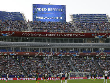 A giant screen reports an incident is being investigated by VAR (Video Assistant Referee) during the Confederations Cup, Group B soccer match between Germany and Cameroon, at the Fisht Stadium in Sochi, Russia, Sunday, June 25, 2017. (AP Photo/Thanassis Stavrakis)