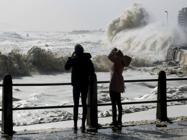 Huge waves slam into the promenade during heavy storms in Cape Town. AP