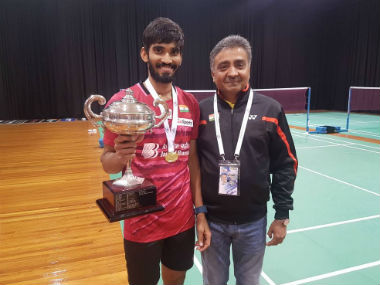 Australian Open 2017 winner Srikanth Kidambi poses with a member of the support staff. Image courtesy: Twitter/@BAI_Media