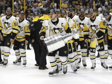 Pittsburgh Penguins' Sidney Crosby celebrates with the Stanley Cup after defeating the Nashville Predators. AP