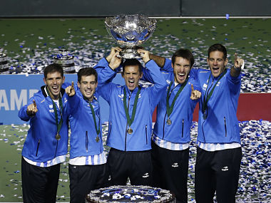 File - This is a Sunday, Nov. 27, 2016 file photo of Argentina's team as they lift the Davis Cup trophy after winning the final against Croatia in Zagreb, Croatia. The Davis Cup and Fed Cup are planning to combine forces into a World Cup of Tennis. A three-year deal starting in 2018 to combine the events was announced Wednesday June 28, 2017, by the International Tennis Federation. The changes still need to be approved at the federation's annual general meeting in August in Vietnam. (AP Photo/Darko Bandic/File)
