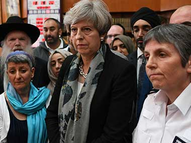Britain's Prime Minister Theresa May, 2nd right, and Metropolitan Police Commissioner Cressida Dick, right, talk to faith leaders at Finsbury Park Mosque in north London. AP