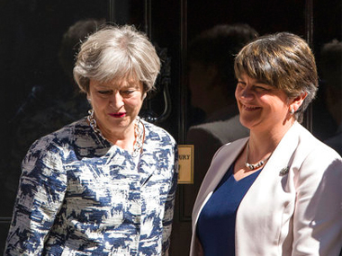 Britain's Prime Minister Theresa May welcomes Democratic Unionist Party (DUP) leader Arlene Foster, right, outside 10 Downing Street in London on Monday. AP