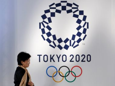Tokyo governor Yuriko Koike walks past the Tokyo 2020 Olympic games emblem during the Olympic and Paralympic flag-raising ceremony at Tokyo Metropolitan Government Building in Tokyo, Japan, September 21, 2016. REUTERS/Toru Hanai - RTSOR6R