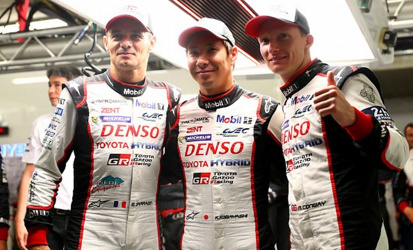 The Toyota Gazoo Racing TS050 drivers (L-R) Stephane Sarrazin, Kamui Kobayashi and Mike Conway celebrate after claiming pole position during qualifying for the Le Mans 24 Hour Race. Getty