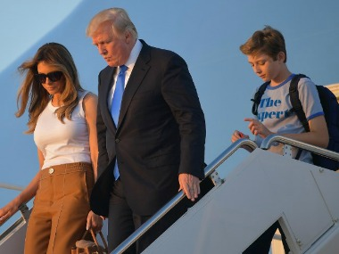 First Lady Melania and Donald Trump with son Barron. AFP