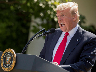 President Donald Trump speaks about the US role in the Paris climate accord on Thursday. AP