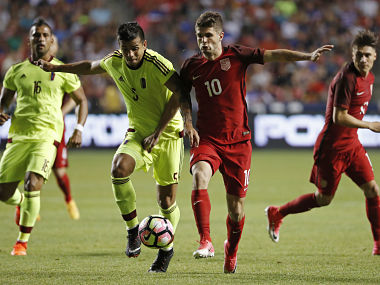Venezuela's midfielder Francisco Flores and United States's Christian Pulisic fight for the ball. Reuters