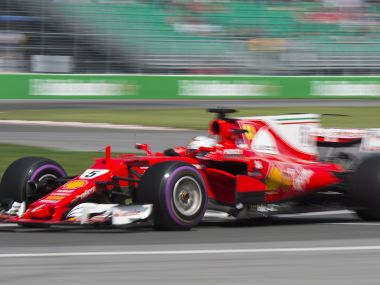 Ferrari driver Sebastian Vettel, of Germany, takes a turn at the Senna corner during the third practice session at the F1 Canadian Grand Prix auto race, Saturday, June 10, 2017, in Montreal. (Graham Hughes/The Canadian Press via AP)