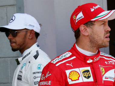 File image of Lewis Hamilton and Sebastian Vettel. Reuters
