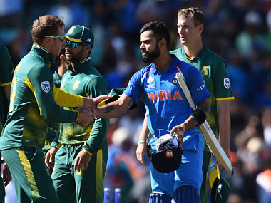 India's captain Virat Kohli shakes hands with South Africa's after Sunday's win. AFP