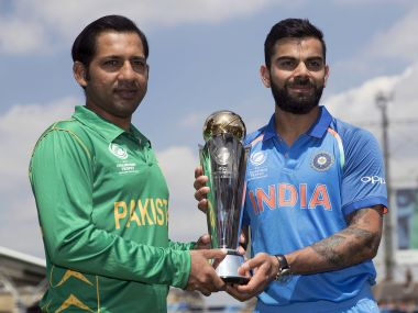 India's captain Virat Kohl and Pakistan's captain Sarfraz Ahmed pose for a picture with the trophy. AP