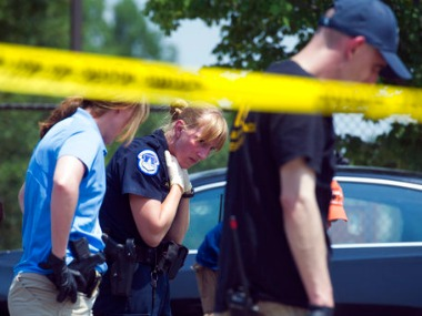 Crime scene investigators search for evidence at the scene of a multiple shooting in Alexandria on Wednesday. AP