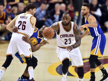 LeBron James (23) goes for a loose ball against Golden State Warriors in Game 3. Reuters