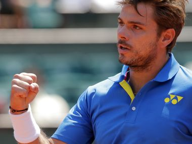 Switzerland's Stan Wawrinka in action against Ukraine's Alexandr Dolgopolov in French Open. AP