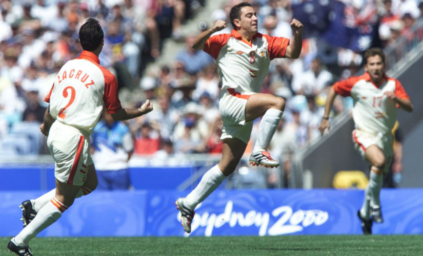 Xavi Hernandez celebrates with his teammates Lacruz (L) and Tamudo (R) after scoring the first goal for his team against Cameroon during the men's gold medal match of the Olympic soccer tournament in 2000. Reuters