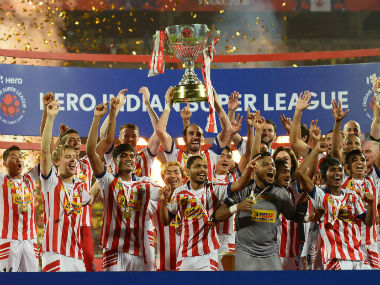 ATK celebrate with the ISL trophy after winning the final against Kerala Blasters FC last year. Sportzpics