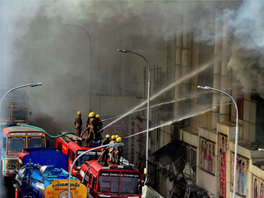 Fire personnel dousing a massive fire that broke out at a textiles shops in T Nagar in Chennai on Wednesday. PTI