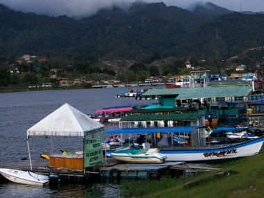 Boats are docked at the reservoir where a ferry sank in Guatape, Colombia. AP