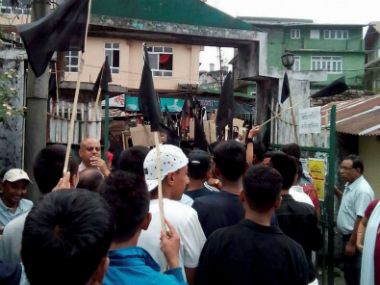 Gorkha Janmukti Morcha supporters waving black flags on the streets of Darjeeling on Thursday. PTI