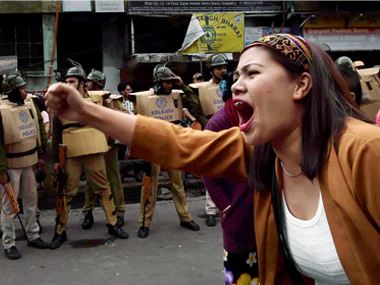 A GJM supporter shouts slogans at a protest rally during their in Darjeeling on Thursday. PTI