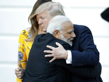 Narendra Modi is welcomed by US President Donald Trump. AP