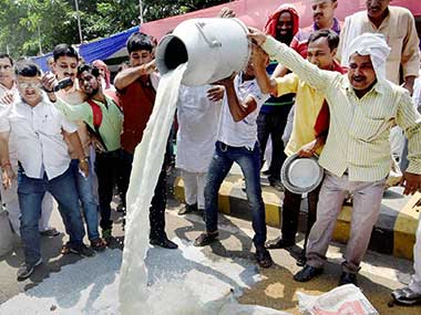 Farmers spilling milk on the road during a state-wide strike in Maharashtra. PTI