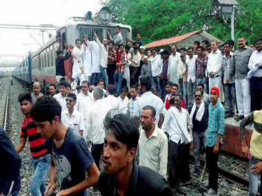 Farmers in madhya Prdaesh block train during their protest. PTI
