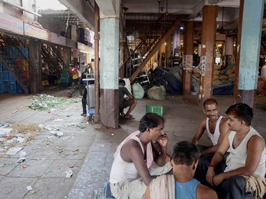 Navi Mumbai: Mathadi workers sitting idle on the first day of farmers' stike for their various issues at APMC vegetable market on Thursday. PTI Photo