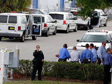 Police vehicles line up outside the scene of a shooting where there were five were killed in an industrial area near Orlando. AP