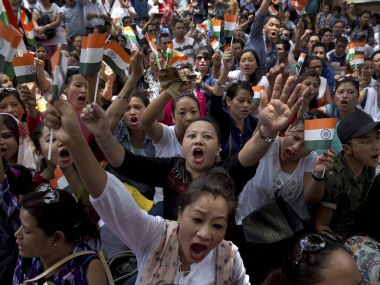 Protesters demanding the creation of separate state of Gorkhaland, shout slogans at a protest in New Delhi on Sunday. The protestors also demanded immediate removal of paramilitary forces from Darjeeling. PTI