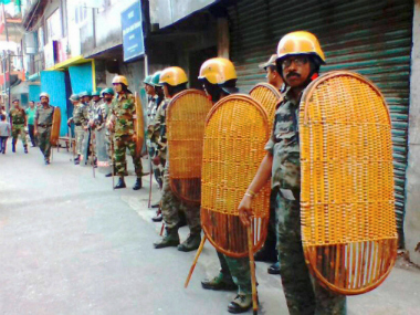 Security personnel stand guard Kurseong at during strike in Darjeeling on Wednesday. PTI
