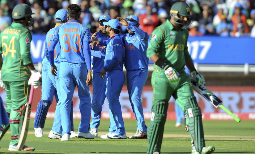 Indian players celebrate as Pakistan's Imad Wasim is dismissed during the 2017 Champions Trophy match at Edgbaston. AP
