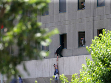 Rescue operation at Iran's parliament building. AP