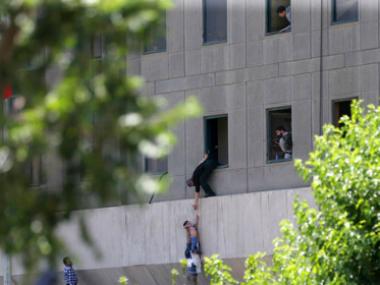 Rescue operations at Iran's parliament building. AP