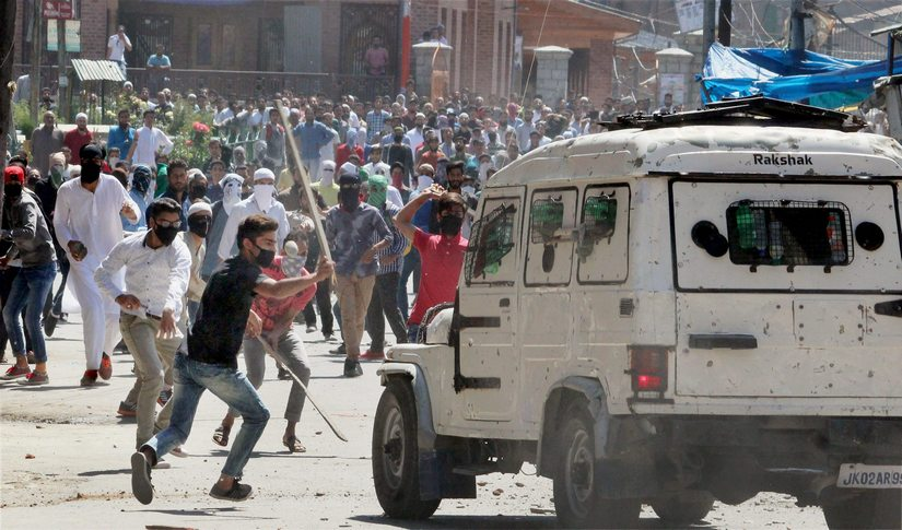 Kashmiri youths damage a police jeep in Srinagar on Friday. PTI