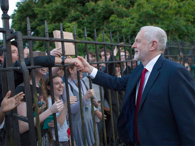 Labour leader Jeremy Corbyn waves to supporters after taking part in the BBC Election Debate on 31 May. AP