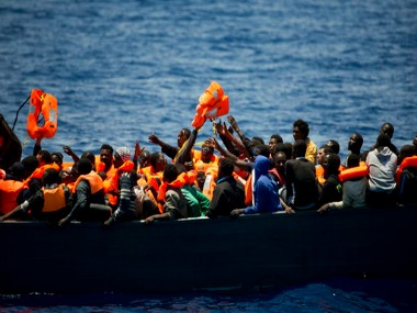 File image of Migrants trying to reach live vests in the Mediterranean Sea. AP