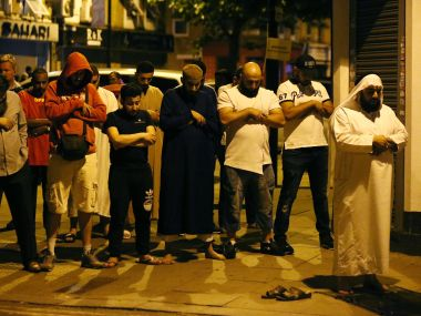 Group of people pray at the site where a van rammed into worshippers outside the Finsbury Park mosque in north London on Monday. Reuters