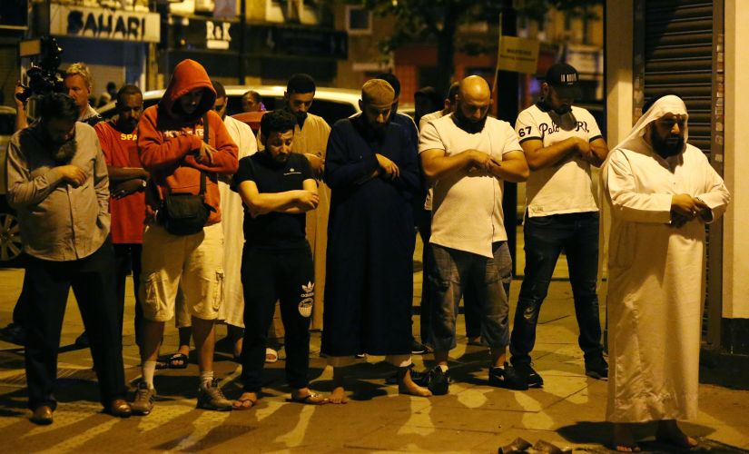 Group of people pray near the Finsbury Park mosque. Reuters